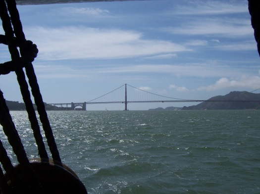 The Golden Gate Bridge, and the waters of San Francisco Bay framed by the ship's rig.