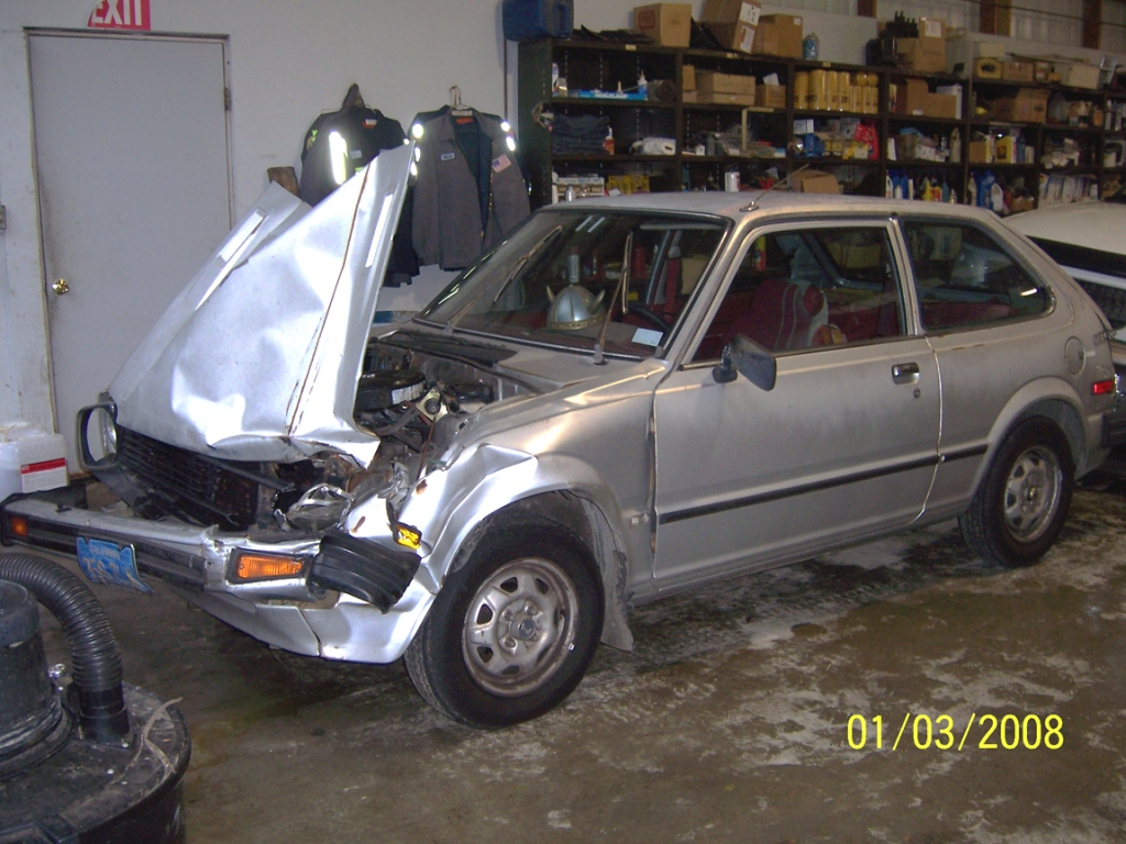 Wrecked Honda in the mechanic's garage