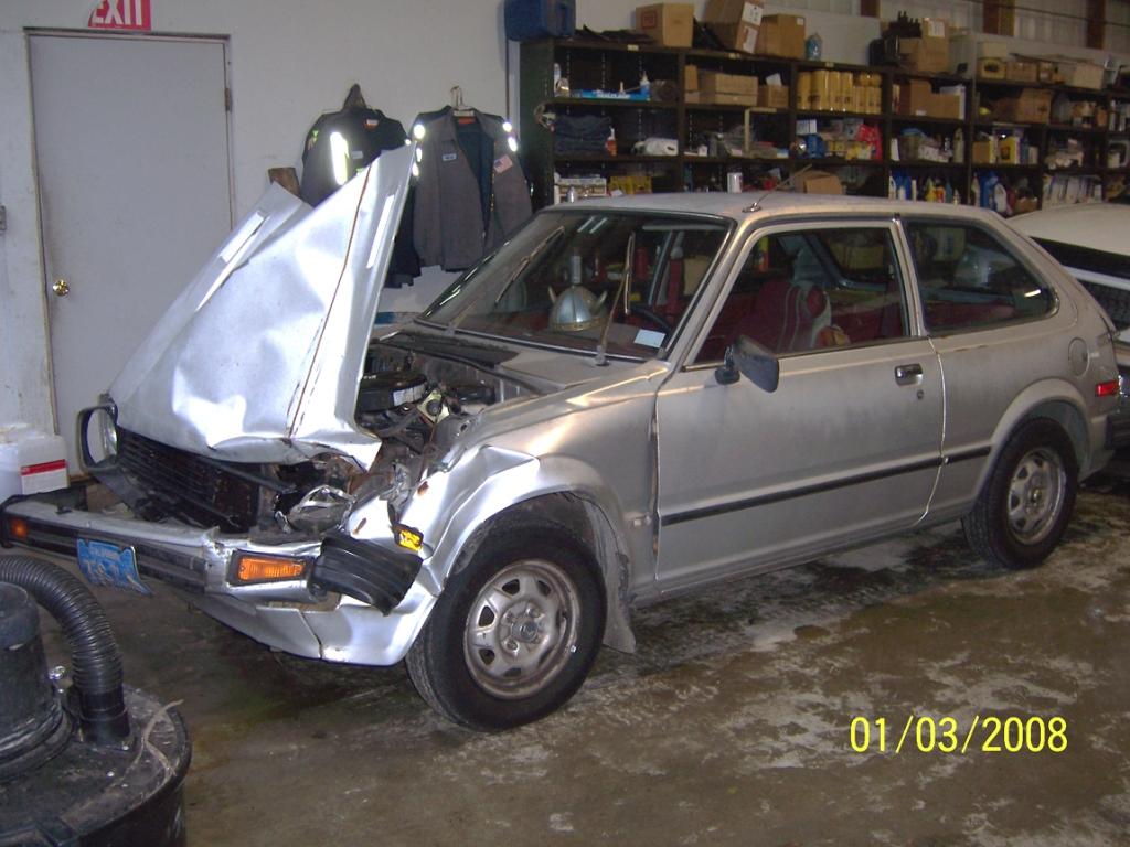Wrecked Honda in the mechanic's garage