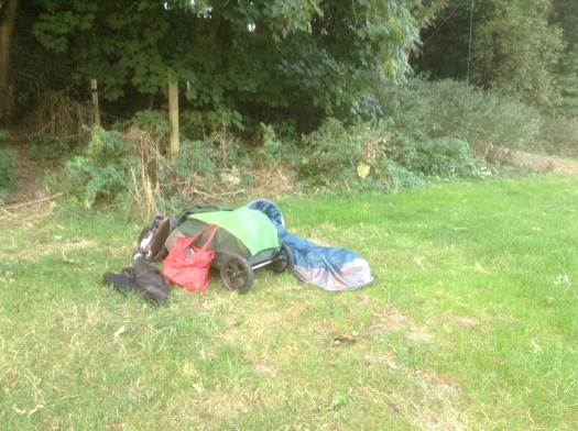 Loaded bike trailer and laid out bivy sack in Alfriston Camping Park