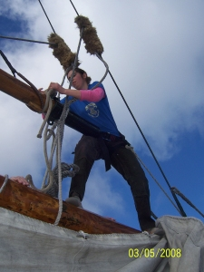 Woman helping to rerig sailing ship