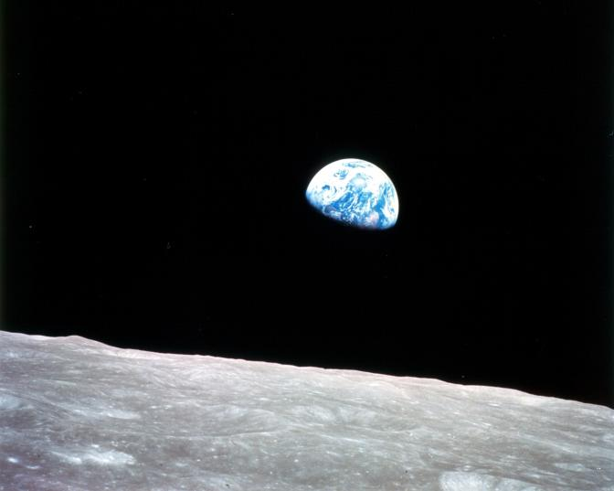 Gibbous Earth rising over moon