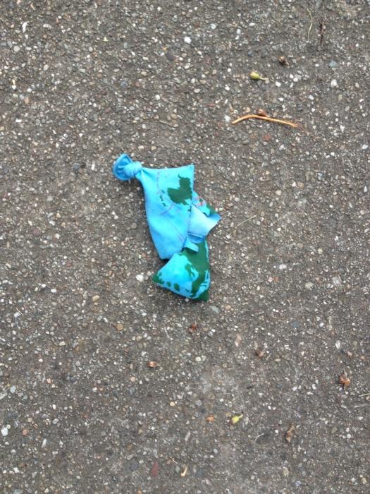 Earth balloon, lying deflated in the street